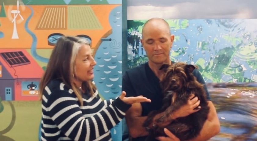 Leelee the dog with man and woman