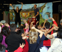 Children participate in a musical performance
